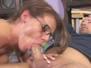 Big-titted mature woman stuffs cock in mouth and beaver