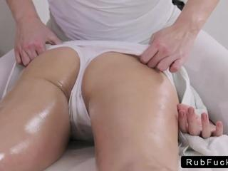 Oiled brunette ass and pussy massaged