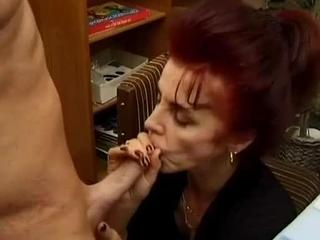 Grandma showing us how to play with her hairy pussy. After her fingers gets boring she starts using a selection of toys to stuff her hole. A guy enters the scene to get his cock sucked, and what a great job she does. ASo this 62 year old next door wife had a guy over to show her a wide selection of dildos. She soon find the salesmans cock more interesting than these plastic replacements, so out of nowhere some serious cocksucking and fucking takes off.ll ending with a lovely cum-in-mouth finale.