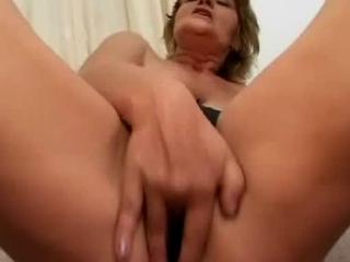 This 53 year old lady asked us to come and film her while rubbing her pussy - it was a fantasy of hers. We found a good location for the shoot on top of the stairs in her huge mansion (yeah, she didnt get paid to do this). She showed us her skills in fingering her tight pussy and a little bottle action as well. Yet another great solo video.