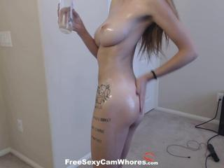 Cute camgirl with big tits oils up for her steamy solo session