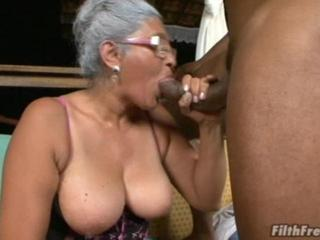 Grey-Haired GILF Blows Dark Manhood