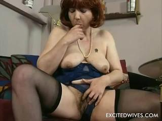 Home alone feeling horny. This 48 year old women will show us how to rub an old hairy pussy in todays solo-scene. Dressed up in lingerie watching a couple of her husbands xrated magazines this lady starts to masturbate her wet hairy old pussy untill it all ends with a well deserved orgasm.