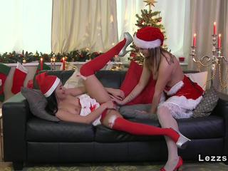 Two Santa lesbians fingering on the sofa